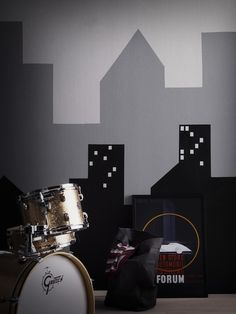 Create shapes by using masking tape or card to make this fab paint effect perfect for a boys bedroom