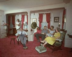 Walt, along with his daughters Diane and Sharon, wife Lilly, and a guest enjoy some quiet time at his private apartment on Main Street, U.S.A.