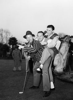 Original caption: 28 Jan 1944, Los Angeles, California, USA — Lest the two crooners, Crosby and Sinatra, come to blows as they vie for the amateur trophy, Bob Hope sandwiches himself between them to keep peace. Giving the lie to rumors that a good gust of wind will blow him away, Swoonatra carries his own heavy golf bag—but then Hope has to carry Frank. Bing and Frank will compete in a professional and amateur golf meet, to be held on January 29th, the proceeds of which will be used to buy…