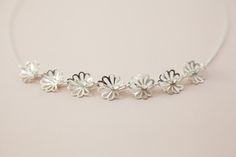 Palmette silver necklace with seven flowers by EevaLovisa. www.eevalovisa.com Lovisa Jewellery, Contemporary Jewellery, Precious Metals, Jewelry Design, Bracelets, Flowers, Silver, Accessories, Bracelet