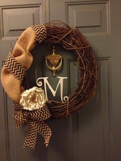 Twig wreath with burlap chevron ribbon and some burlap and a polka dot burlap flower. Painted my families last initial. All from Hobby lobby!