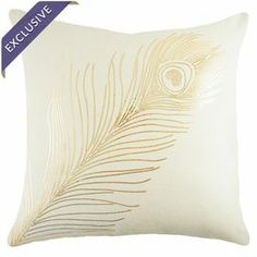 """Handmade in the USA, this chic cotton pillow showcases a sequined peacock feather motif for shimmering style.    Product: PillowConstruction Material: Cotton and sequinsColor: Gold and whiteFeatures:       Handmade by TheWatsonShop  Insert included with zipper enclosure  Made in the USA Dimensions: 16"""" x 16"""" Cleaning and Care: Spot clean"""