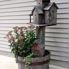 Old whiskey barrel w/birdhouses