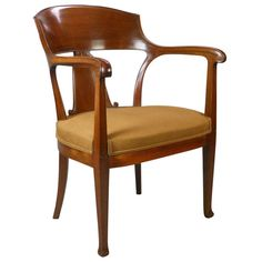 A Swedish Mahogany Art Nouveau Chair | From a unique collection of antique and modern armchairs at https://www.1stdibs.com/furniture/seating/armchairs/