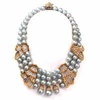 This impressive Buccellati diamond pearl necklace of exquisite design is of Italian provenance and a constituent part of a set (demi-parure) together with a pair of matching earrings. This captivating necklace is crafted in a combination of solid 18K white and yellow gold, incorporating lustrous silver silverish blue gray cultured pearls of excellent nacre , silk-strung in two and three strands. Dover Jewelry