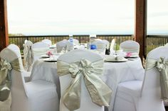Wedding Decor- White Linen with White Chair Covers and Bows