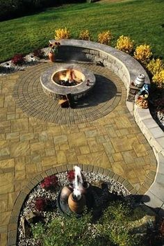 Firepit with seating~would love to build a little bench like that along the back side of my fire pit.