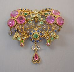 """HOBE fabulous curved brooch with pink, yellow, blue and green unfoiled rhinestones set in gold tone wire work, dangles, not signed but with hang tag, 3"""" by 3"""". Patent number 143,486 from 1946. This piece in another color way can be seen in the book """"American Costume Jewelry: Art & Industry Volume 1"""" on page 215, where it is dated 1939 designed by William W. Hobe"""
