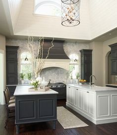 Gray Kitchen......this is an amazing space, i would change the vent hood to black,and add black distressing over the white island, but overall a great space