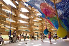Woods Of Net by Takaharu + Yui Tezuka / Tezuka Architects. Interlocking timber logs are stacked to house this permanent installtion by colorful net artist Toshiko Horiuchi Macadam.