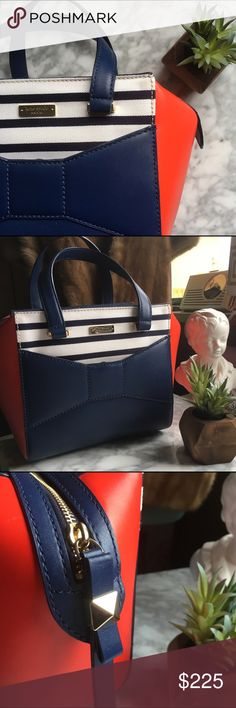 Kate Spade•2 Park Avenue Beau Shopper; French Navy Adorable red, white, and blue nautical inspired handbag! This bag is gently used & in excellent condition. HOWEVER, there are some small black marks on the back of the bag. It looks at though something rubbed against it perhaps. I have done my best to show them in photos. A professional cleaner may be able to remove them! Otherwise, this bag is exceptionally clean & in nearly new condition. 8.5hx15wx4.25d. 4.25 drop. Leather & fabric. kate…