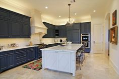 Kitchen - double ovens, built-in refrigerator/freezer, gas range, custom finishes by Segretto.