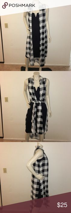 Cotton express vest Vest was worn once. Bought at Nordstrom Rack. Size large but would fit a med. shown in the pictures with a dress but can be worn with pants or shorts style is up to you. cotton express Jackets & Coats Vests