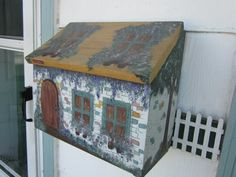 I painted this mailbox from a House Beautiful pattern 15 years ago...I love my mailbox (it even won a best of show blue ribbon at the County Fair).
