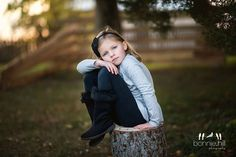 Bonnie Hill Photography #bonniehillphotography #childrensportraiture Children's portraiture One of my favorites.  We found a sweet stump right where the fence was perfect and she connected with the camera beautifully.