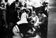 Mrs. Robert Kennedy and others surround a mortally wounded Robert Kennedy in the kitchen at the Ambassador Hotel, June 1968.   (Photo: Bill Eppridge—Time & Life Pictures/Getty Images)