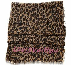 Leopard Louis Vuitton Scarf - an oldie, but a goodie.