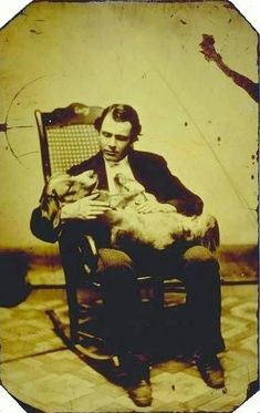"Just found my new favorite website ""My Daguerreotype Boyfriend."" Where early photography meets extreme hotness. Love it!       ca. 1860-80's, [tintype self-portrait of photographer E.A. Scholfield in a rocking chair, cradling a dog], E.A. Scholfield  via Connecticut History Online, Mystic Seaport, Scholfield Collection"