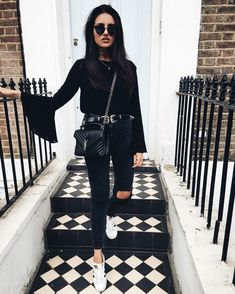 Black top flared sleeve black jeans white sneakers All black