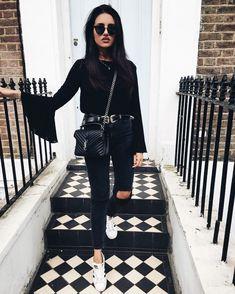 Black top flared sleeve black jeans white sneakers   All black