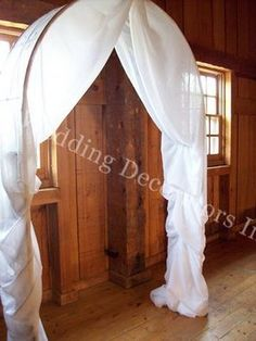 Wedding ceremony archway Lacy this is what i was meaning tulle like this and cover the back if we do it at that one place!