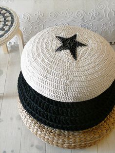 La Casa Decoto Crocheted Pouf: This chic hand-crocheted star pouf in ecru and black ($78) features removable outer covers for easy cleaning.