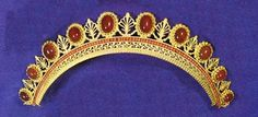 Oval cabochon-cut cornelians above a row of coral beads in a pinchbeck setting and open-work in neo-classical style. French or Italian, about 1810-1825.