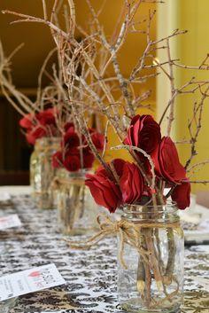 DIY paper rose with sticks centerpiece via The Hollie Rogue blog