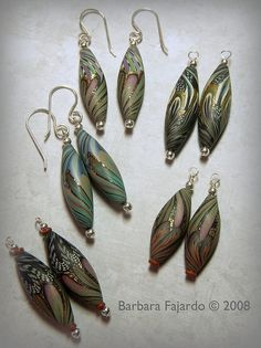 Barbara Fajardo. Would love to know how she did these. Love the sparkle. I'm sure there is a layer or two of gold leaf. Lovely!