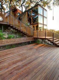 Architecture: Exciting Modern Architecture Ideas With Steel Architecture Ideas Also Long Wooden Garden Chair Also Wooden Deck And Charming Staircase To Entrance Also Modern House Design: Breathtaking Nuance in Best Captivating Contemporary Architecture Design Ideas
