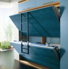 I really like this idea - fold out beds. Could also be used for tables, benches, counters, desks, etc.