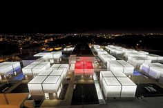 The residences in the Alcabideche Social Complex, a retirement home developed by Guedes Cruz Architects in Portugal, light up at night to allow residents to remain out and about. If an emergency arises, an alarm is triggered that turns the façade bright red.