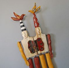 Elizabeth Frank uses fallen aspen trees and found objects for her art.