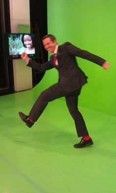 Chris Warren celebrating Valentine's Day with his red socks on Weather Center 2/14/2012