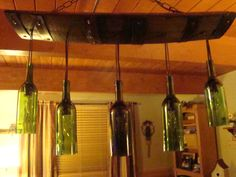 Wine Bottle Chandelier by WineBarrelFurniture on Etsy, NEED THIS