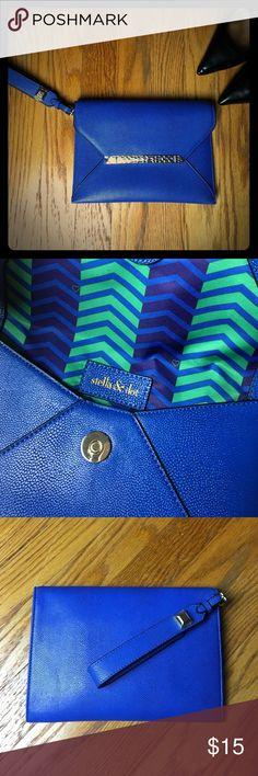 "Stella & Dot Envelope Clutch/Wristlet Stella & Dot Envelope Clutch/Wristlet  Color: Blue Length: 9"" Height: 6""  Blue and green chevron lining. Gold accent hard wear. Stella & Dot Bags Clutches & Wristlets"