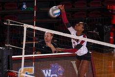 Danielle Smith, an #Elon women's volleyball right side/outside hitter, smashes the ball against Campbell.