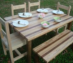 Reclaimed wood table & bench.  Lovely.