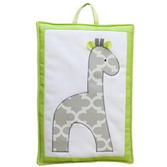 Adorable giraffe wall art is completely made of fabric and safe to hang in a nursery out of baby's reach