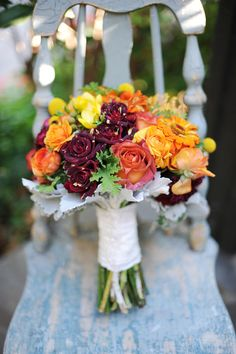 Nice fall mix with abracadabra roses (burgundy with gold accents)