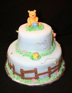 Classic Pooh Baby Shower - All decorations made with Fondant and/or gumpaste. This is a Classic Pooh cake not the modern theme. I struggled to get Piglet to look like the older version. I left Pooh out to dry overnight.
