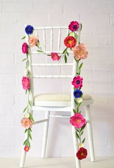 Handmade Paper Flower Garland. This paper flower garland makes an absolutely lovely and versatile wedding decoration. Made in east london, each flower is curled and folded by hand and then attached to a over 1 metre of paper foliage.