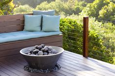 Landscape Design and Home and Garden Retail Showroom — Molly Wood Garden Design - I love the big round rocks in the fire pit
