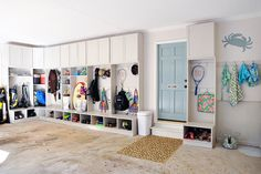 Mud room/garage like the storage above. Could use it for winter coats or Rain boots when they aren't needed. Like the double coat hooks.  One for jacket one for book bag.