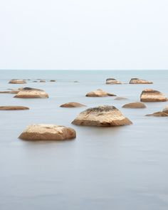 Soothing large wall art landscape prints of rocks in the calm water of Lake Huron at Kettle Point, Ontario, Canada. Captured early one fall morning this image highlights the quiet beauty of the Lake Huron shoreline.