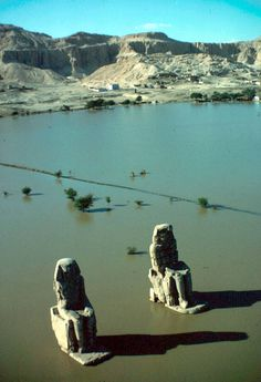 Colossi of Amenhotep III (Memnon) at Thebes, Photo by Eliot Elisofon. As you can see, the Nile has flooded at the time of this image. Ancient Egyptian Art, Ancient Ruins, Ancient History, Luxor, Old Egypt, Egypt Art, Amenhotep Iii, Kemet Egypt, Ancient Architecture