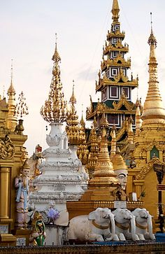 Shrines and pagodas at Shwedagon Pagoda, 2500 year old sacred Buddhist site, covered in gold, in evening light, Yangon, Myanmar (Burma), Asia