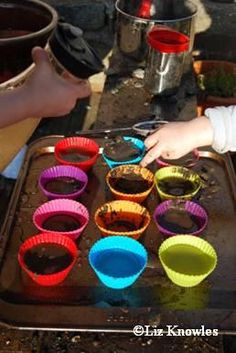"For mud kitchen! Number the tins and encourage the children to add ""that many"" twigs or sticks to each cup!"