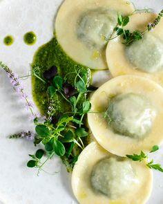 Light, early summer ravioli with basil pesto.