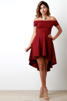 This simply cute skater dress features a soft stretchy knit fabrication, off the shoulder neckline, and ruffled skirt finished with high-low hemline. Accessories sold separately. Made in U.S.A. 65% Ra